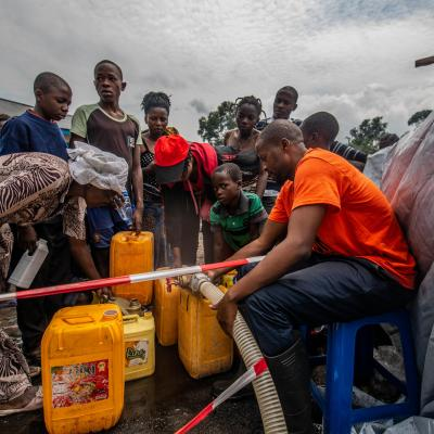 People filling jerry cans with water at MSF centre in Sake, DRC